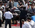 عکس:قربانی کردن گوسفند مقابل احمدینژاد